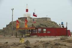 Stara latarnia morska przy dennym brzeg w Arica, Chile Obrazy Stock