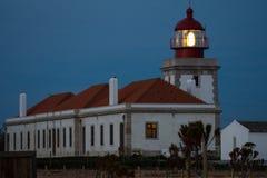 Stara latarnia morska przy zmierzchem Obraz Stock