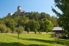 Stara Lubovna castle. Historic wooden hut under Stara Lubovna castle in Slovakia stock images