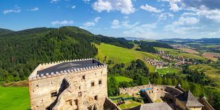 View from the top of castle wall. Stara Lubovna, Slovakia - AUG 28, 2016: view from the top of castle wall. beautiful rural landscape. village at the foot of the Royalty Free Stock Photography