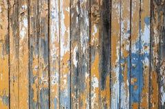 Stara nieociosana drewniana ściana z krakingową farbą Obrazy Royalty Free