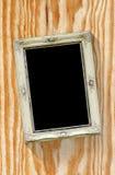 Stara obrazek rama na Drewnianej teksturze Obraz Royalty Free