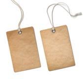 Stara papierowa sukienna etykietka lub etykietka ustawiamy odosobnionego Obrazy Stock