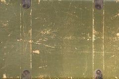 Stara podława khaka walizka z złotym cieniem zdjęcie stock