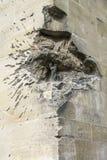 Stara religijna figurka w kamiennej ścianie Zdjęcie Royalty Free