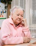 Stara smutna kobieta Fotografia Royalty Free