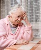 Stara smutna kobieta w domu Obraz Royalty Free