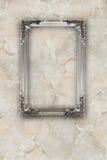 Stara srebna obrazek rama na marmurze wykonuje tło Zdjęcie Stock