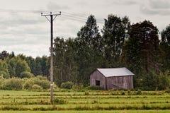 Stara stajnia liniami energetycznymi Zdjęcie Royalty Free