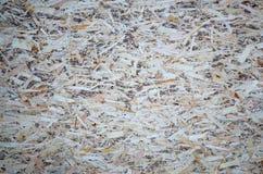 Stara ukierunkowywająca pasemko deska OSB, fiberboard tekstura tło Prześcieradło zrobi brown drewniani układy scaleni naciskający fotografia stock