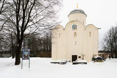 Staraya Ladoga, Russia, January 5, 2019. View horizontal of the medieval Orthodox church in the convent and pilgrims around it. royalty free stock image
