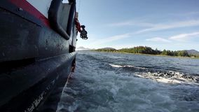 Starboard side of a sailing vessel moving down river stock video footage