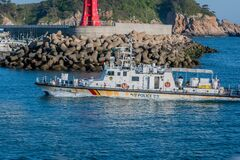Free Starboard View Of Korean Police Frigate Entering Seaport Stock Photography - 219736992