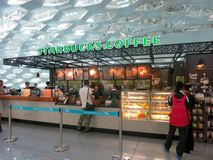 Starbucks at Airport With Cool Ceiling Royalty Free Stock Photography
