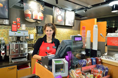 Starbucks Cafe. GENEVA, SWITZERLAND - NOVEMBER 18, 2015: barista in Starbucks Cafe. Starbucks Corporation is an American global coffee company and coffeehouse stock photos