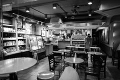 Starbucks Cafe. HONG KONG - JUNE 03, 2015: Starbucks Cafe interior. Starbucks Corporation is an American global coffee company and coffeehouse chain based in royalty free stock photos