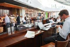 Starbucks cafe interior in airport Stock Photos