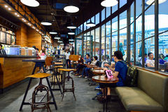Starbucks Cafe interior. BANGKOK, THAILAND - JUNE 21, 2015: Starbucks Cafe interior. Starbucks Corporation is an American global coffee company and coffeehouse royalty free stock photography