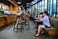 Starbucks Cafe interior. BANGKOK, THAILAND - JUNE 21, 2015: Starbucks Cafe interior. Starbucks Corporation is an American global coffee company and coffeehouse royalty free stock images