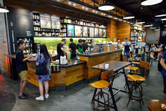 Starbucks Cafe interior. BANGKOK, THAILAND - JUNE 21, 2015: Starbucks Cafe interior. Starbucks Corporation is an American global coffee company and coffeehouse stock photos