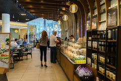 Starbucks Cafe interior. DUBAI - OCTOBER 15: Starbucks Cafe interior in the Dubai Mall on October 15, 2014 in Dubai, UAE. Starbucks is the largest coffeehouse royalty free stock images