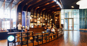 Starbucks Cafe interior. DUBAI - OCTOBER 15: Starbucks Cafe interior in the Dubai Mall on October 15, 2014 in Dubai, UAE. Starbucks is the largest coffeehouse stock photos