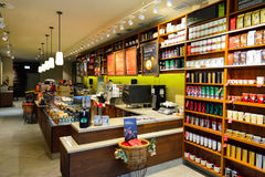 Starbucks Cafe interior. GENEVA, SWITZERLAND - NOVEMBER 18, 2015: Starbucks Cafe interior. Starbucks Corporation is an American global coffee company and stock images
