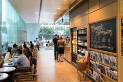 Starbucks cafe interior. HONG KONG - MAY 05, 2015: Starbucks cafe interior. Starbucks is the largest coffeehouse company in the world, with more then 23000 royalty free stock photos