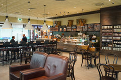 Starbucks cafe interior. MOSCOW - SEP 24: Starbucks cafe interior in Sheremetyevo airport on September 24, 2014. Starbucks Corporation is an American global royalty free stock images