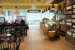Starbucks cafe interior. MOSCOW - SEP 24: Starbucks cafe interior in Sheremetyevo airport on September 24, 2014. Starbucks Corporation is an American global stock images
