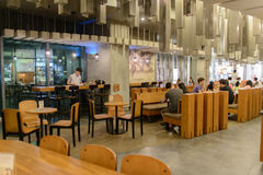 Starbucks Cafe interior. SHENZHEN, CHINA-APRIL 13: Starbucks Cafe interior on April 13, 2014 in Shenzhen, China. Starbucks Corporation is an American global royalty free stock images