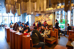 Starbucks Cafe interior. SHENZHEN, CHINA - JAN 11: Starbucks Cafe interior on January 11, 2015. Starbucks Corporation is an American global coffee company and stock photography