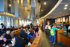 Starbucks Cafe interior. SHENZHEN, CHINA - JAN 11: Starbucks Cafe interior on January 11, 2015. Starbucks Corporation is an American global coffee company and stock images