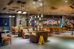 Starbucks Cafe at night Royalty Free Stock Image