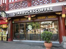 Starbucks Coffee in Ancient Building in China Stock Image