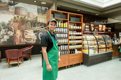 Starbucks Coffee cafe interior. DUBAI, UAE - MARCH 10, 2015: Starbucks staff. Starbucks Corporation, doing business as Starbucks Coffee, is an American global royalty free stock images