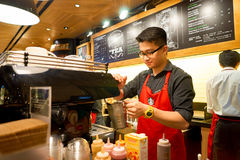 Starbucks coffee shop. HONG KONG - CIRCA NOVEMBER, 2016: barista at a Starbucks cafe in Hong Kong. Starbucks Corporation is an American coffee company and royalty free stock images