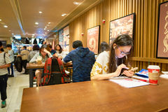 Starbucks coffee shop. HONG KONG - CIRCA NOVEMBER, 2016: a Starbucks cafe in Hong Kong. Starbucks Corporation is an American coffee company and coffeehouse chain royalty free stock photos