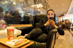 Starbucks coffee shop. HONG KONG - CIRCA NOVEMBER, 2016: woman at Starbucks cafe in Hong Kong. Starbucks Corporation is an American coffee company and Stock Image