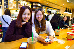 Starbucks. HONG KONG - DECEMBER 25, 2015: customers of Starbucks cafe. Starbucks Corporation is an American global coffee company and coffeehouse chain based in royalty free stock photography