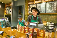 Starbucks. MOSCOW, RUSSIA - CIRCA OCTOBER, 2018: staff at Starbucks in Moscow royalty free stock photo