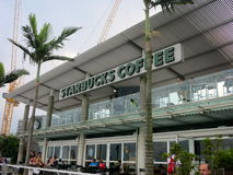 Starbucks - The Name Plate of Starbucks Behind Palm Trees Stock Photo