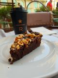 Starbucks reserve in milano coffee cappuccino cake caramel chocolate royalty free stock photography