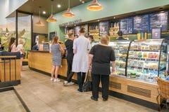 Starbucks. SAINT PETERSBURG, RUSSIA - CIRCA AUGUST, 2017: Starbucks coffee shop at Galeria shopping center. Starbucks Corporation is an American coffee company Stock Image