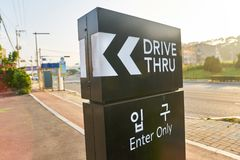 Starbucks sign. BUSAN, SOUTH KOREA - CIRCA MAY, 2017: drive-thru sign at Starbucks coffee shop in Busan. Starbucks Corporation is an American coffee company and stock photo