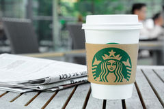Starbucks take away coffee cup with logo on sleeve Royalty Free Stock Photo