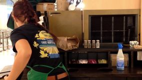 Starbucks worker cleaning workshop table stock video footage