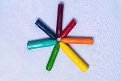 Starburst of color. Colorful crayons bursting out onto a white backdrop Stock Photo