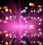 Starburst and night traffic lights of the big city. With reflection. Artistic style. Defocused urban abstract texture background for your design Royalty Free Stock Images