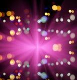 Starburst och natttrafikljus av storstaden Royaltyfria Bilder